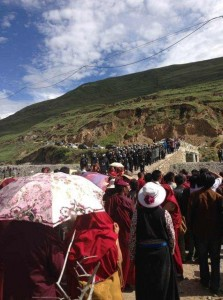 Armed police making their way down to beat, teargas and shoot Tibetans celebrating Dalai Lama's birthday.