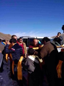 Local Tibetans welcome welcome Kunga Tsayang with ceremonial scarves.
