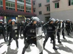 SWAT team with full riot gear performs drills to intimidate local Tibetans