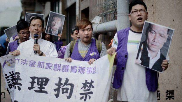 [Photo: BBC] Protesters in Hong Kong call for Pu Zhiqiang's release. Pu Zhiqiang is one of the most prominent Chinese human rights lawyers who had defended Tibetan environmentalist Karma Samdup as well as Chinese artist Ai Weiwei during their trials.