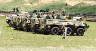 People's Armed Police force atop combat vehicles in Lithang