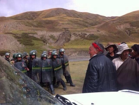 Chinese People's Armed Police face unarmed local Tibetans in October 2013 in Diru County